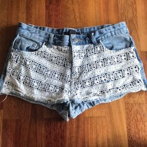 Light blue washed colored jean shorts